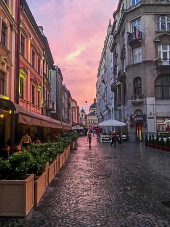 LVIV, UKRAINE - JULY 11:  Beautiful cityscape - Old street after the rain in the center of Lviv at sunset on July 11, 2017 in Lvov, Ukraine Editorial