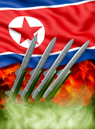 3d illustration - Rockets on the background of the flags of North Korea (DPRK) and fire Stock Photo