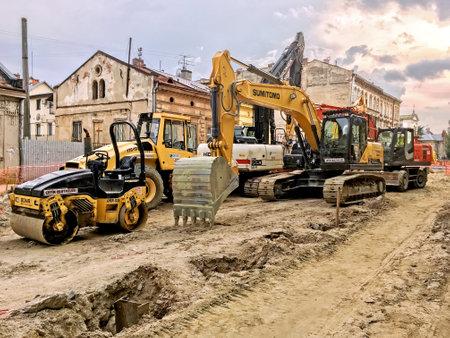 LVIV, UKRAINE - JUNE 23: Construction machinery during the major overhaul of the road in Lychakivska Street in Lviv on June 23, 2017 in Lvov, Ukraine