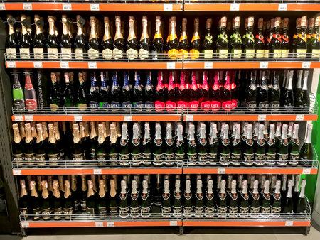 LVIV, UKRAINE - DECEMBER 01: Wine bottles (sparkling wine) close-up on the shelves in the supermarket