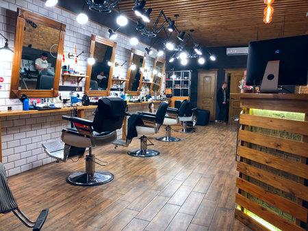 LVIV, UKRAINE - NOVEMBER 19: Empty hall of a men's hairdresser in the center of Lviv on November 19, 2019 in Lvov, Ukraine