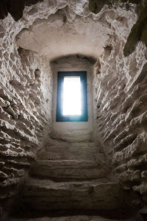 tunnel portals: Window in scandinavian castle in the end of archway