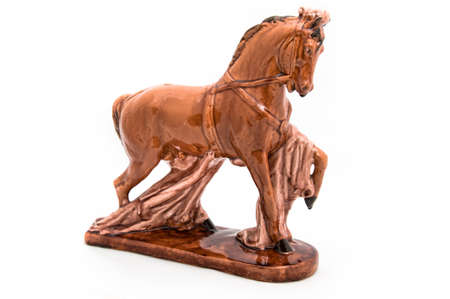 Glossy and old statuette of royal, brown, beautiful horse