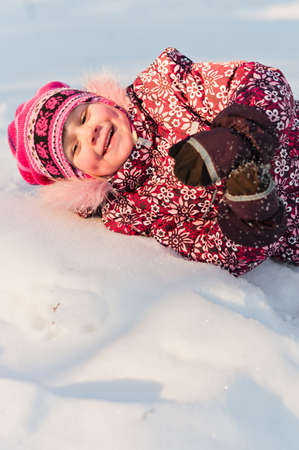 lays: Baby lays on snow and laugh a lot