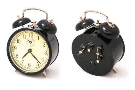 Old black alarm clock, front and back sides
