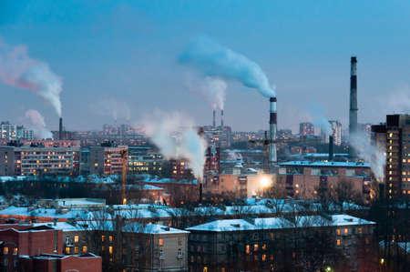 Pipes in industrial district make smoke, Saint-Petersburg, Russia
