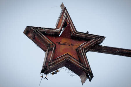Old, dilapidated and destroyed soviet union star sign