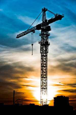 construction project: Crane silhouette at the sunset time, high dynamic range style Stock Photo