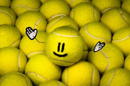 Smiley leader of all yellow tennis balls, metaphor