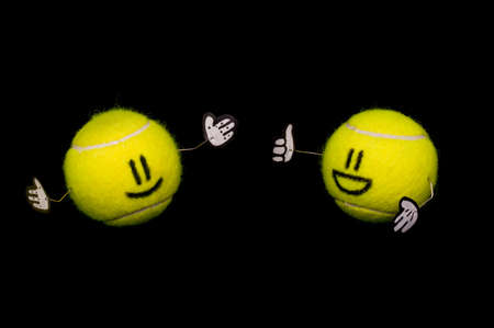 Two happy tennis balls talking with gestures and happyness Stock Photo