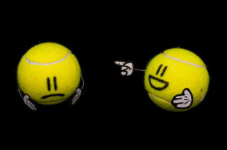 Tennis ball hurting another yellow tennis ball, one laugh, another is sad Stock Photo - 12634200