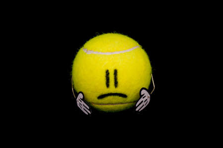 Cute yellow tennis ball is sad and unhappy Stock Photo - 12634199