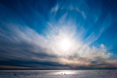 blue ray: Beautiful cloudy and blue sky over ice lake in Saint-Petersburg, Russia Stock Photo
