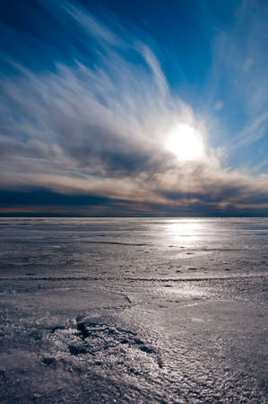 Beautiful blue and cloudy sky over ice lake in Saint-Petersburg, Russia photo