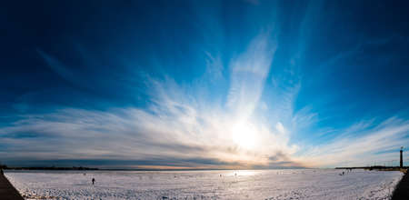 dramatic sky: Beautiful cloudy and blue sky panorama over ice lake in Saint-Petersburg, Russia
