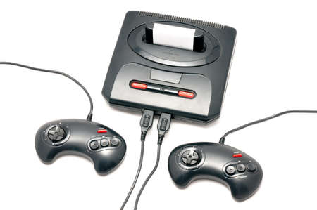 kids playing video games: Isolated black and plastic retro console with two control pads Stock Photo