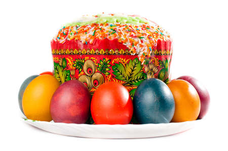 Easter eggs and cake on big plate, all is isolated on white