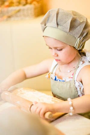 Little girl start cooking pizza and working with dough Stock Photo