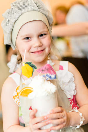 Little girl with hand made milk cocktail with decorations