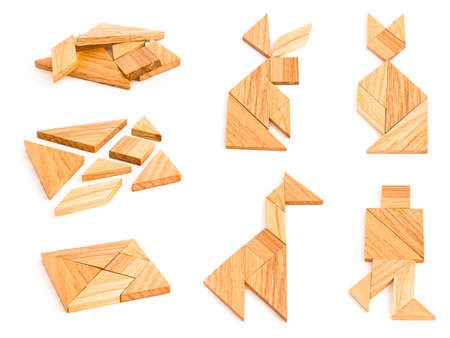 finished: Isolated views of wooden tangram with few finished figures Stock Photo