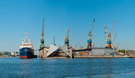 containership: Shipyard with ships panorama at day time with clear sky