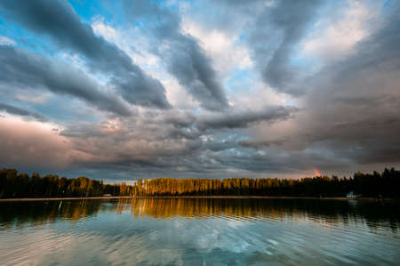 Beautiful cloudscape over the lake with still water photo