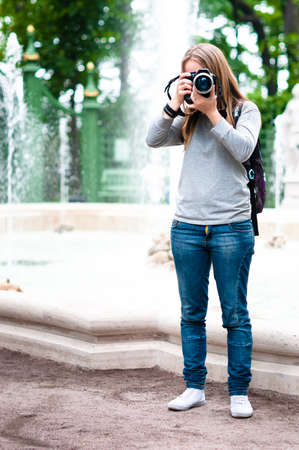 Cute girl taking photos during travel on holidays Stock Photo