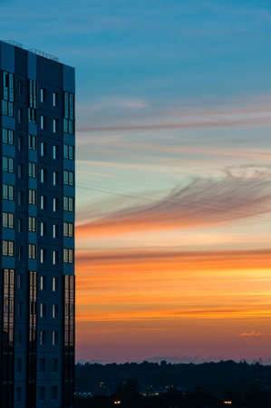 Modern building at sunset with beautiful cloudscape at background Stock Photo