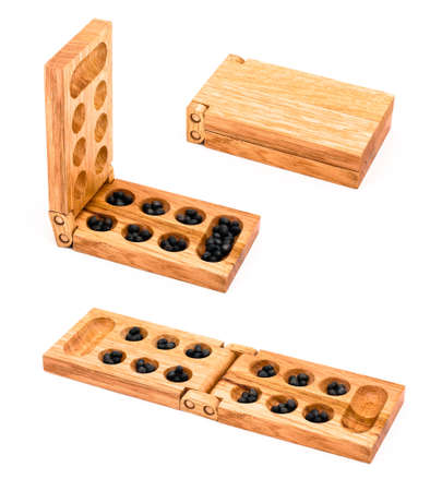 Wooden mancala isolated on white in few different views photo