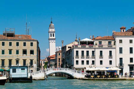 Venice cityscape view with houses and clear sky from water Stock Photo