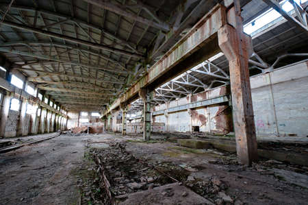 Old and deserted plant interior with weathered walls and overlap