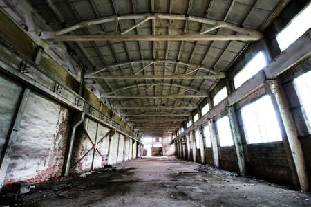 Old and deserted plant symmetrical interior with weathered walls and overlap Stock Photo