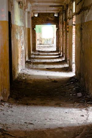 Old and abandoned corridor with shadows rhythm on the flour