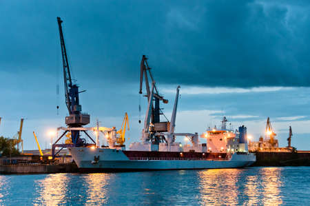 containership: Shipyard with ship at dusk time with beautiful cloudscape