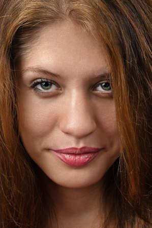 Brunette female face detailed close up with elegant smile