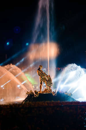 Samson fountain at night with big jet at Petergof, Russia Stock Photo