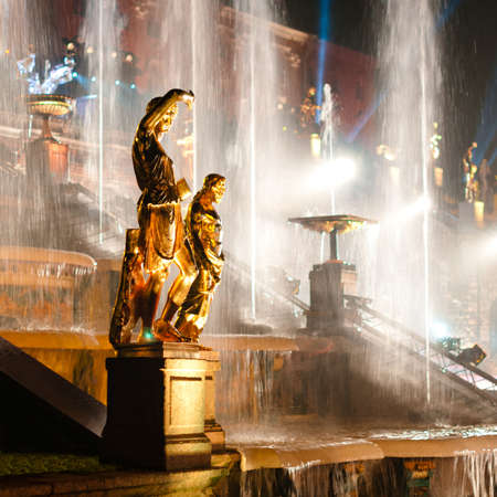 Sculptures with fountain on background at night at Petergof, Russia