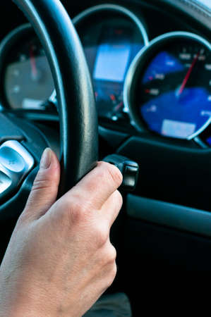 Woman drive car and holds the steering wheel Stock Photo