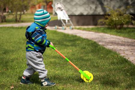 Cute boy mows lawn Stock Photo