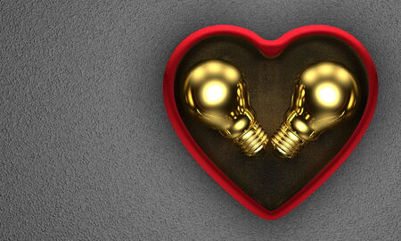 saint valentine s day: Golden ideas for Saint Valentine s Day s present  Golden light bulbs in red heart-shaped box on grey background