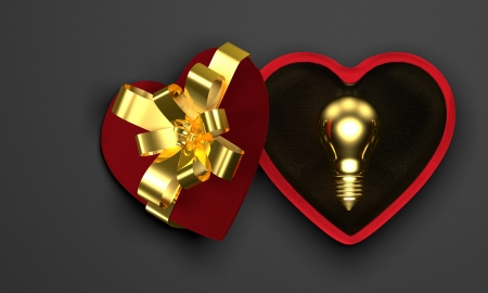 saint valentine   s day: Golden light bulb in red heart-shaped box  Golden idea for present in Saint Valentine s Day s concept
