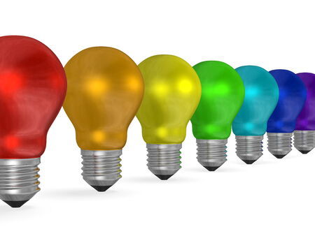 Row of reflective light bulbs of different colors isolated on white background photo