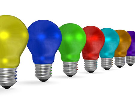 Row of reflective light bulbs of vibrant contrasting colors isolated on white background photo