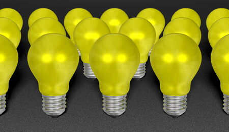 risky innovation: Group of yellow reflective light bulbs on grey textured background  Idea concept