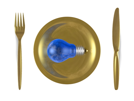 Blue light bulb with sky reflection in it, golden plate, fork and knife isolated on white background. Top view