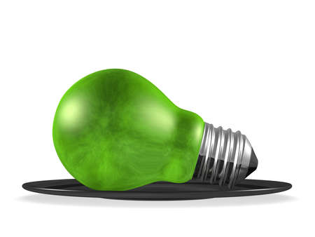 Green light bulb served in black saucer isolated on white background Stock Photo