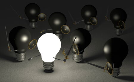 Glowing light bulb fighting against many black ones with swords and shields on dark gray textured background photo