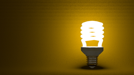 lamp stand: Glowing spiral light bulb on dark yellow textured background