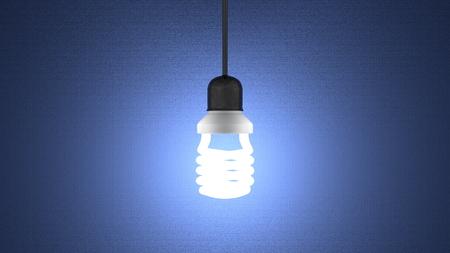 enchufe de luz: Lucir bombilla espiral en el z�calo de la l�mpara que cuelga en el fondo azul oscuro con textura