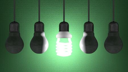 enchufe de luz: Bombilla que brilla intensamente en espiral entre los muertos de tungsteno en portal�mparas colgando sobre fondo de textura de color verde oscuro Foto de archivo